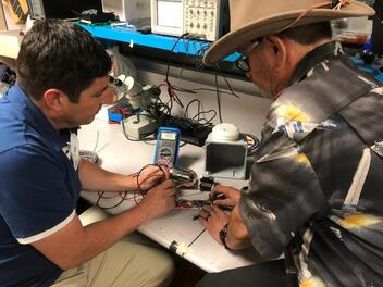 Eddie Villanueva and Robert Wimmer from the AQMD working with ELAC on weather stations and air quality monitoring throughout the Los Angeles air basin.